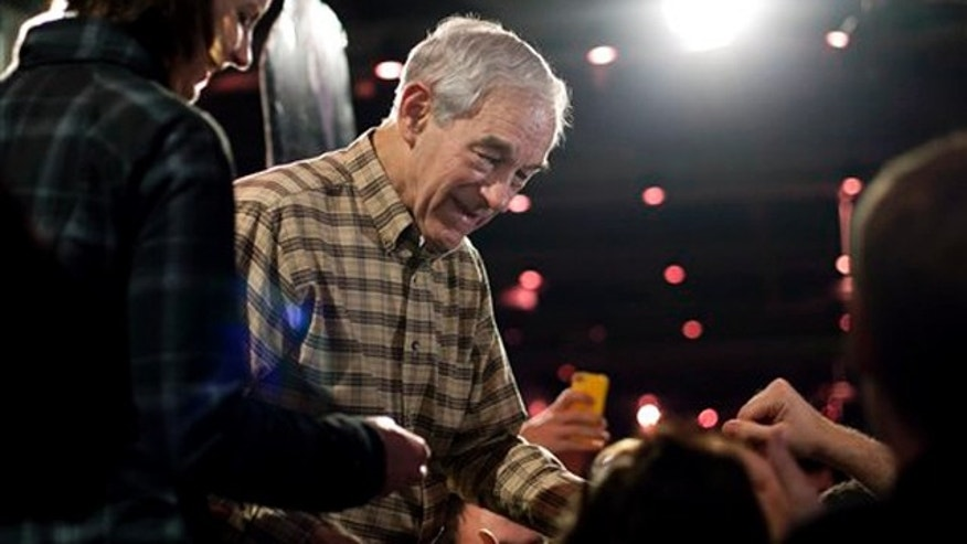 Republican presidential candidate Rep. Ron Paul, R-Texas is seen on stage greeting supporters during a campaign rally in Columbia, S.C., Friday, Jan., 20, 2012. (AP Photo/Pablo Martinez Monsivais)