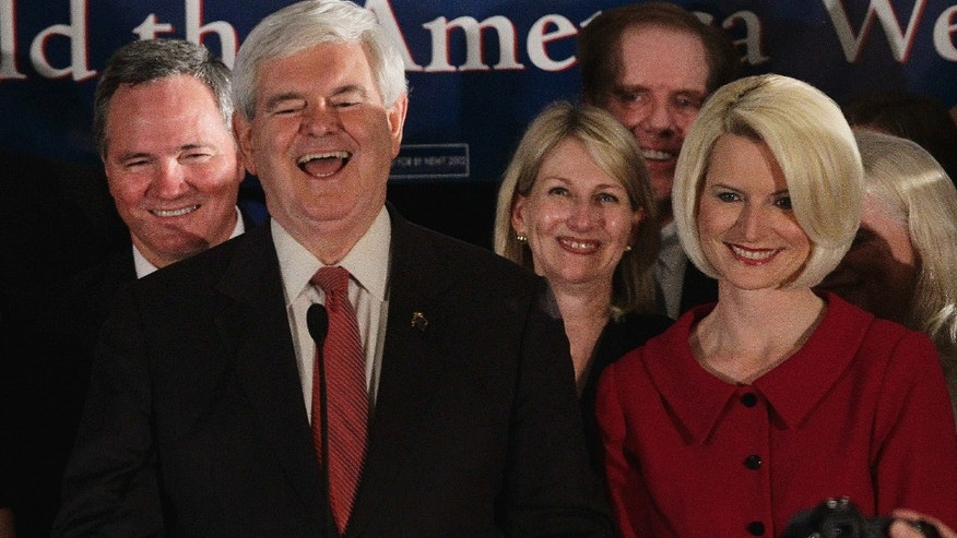 Republican presidential candidate and former House Speaker Newt Gingrich reacts during a South Carolina Republican presidential primary night rally,  Saturday, Jan. 21, 2012, in Columbia, S.C. Callista Gingrich looks on at right. (AP Photo/Paul Sancya)