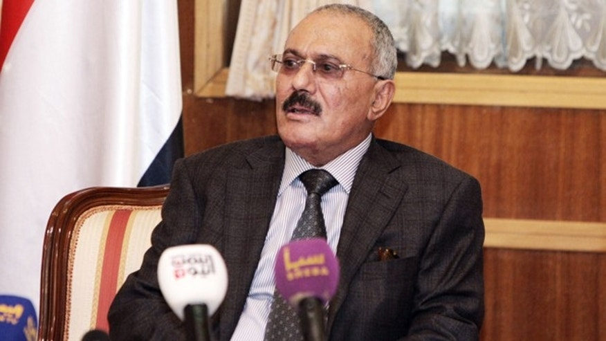 Jan. 22, 2012: In this photo made available by the office of the Yemen presidency, Yemen's President Ali Abdullah Saleh speaks to the state media reporters at the Presidential Palace in Sanaa, Yemen.