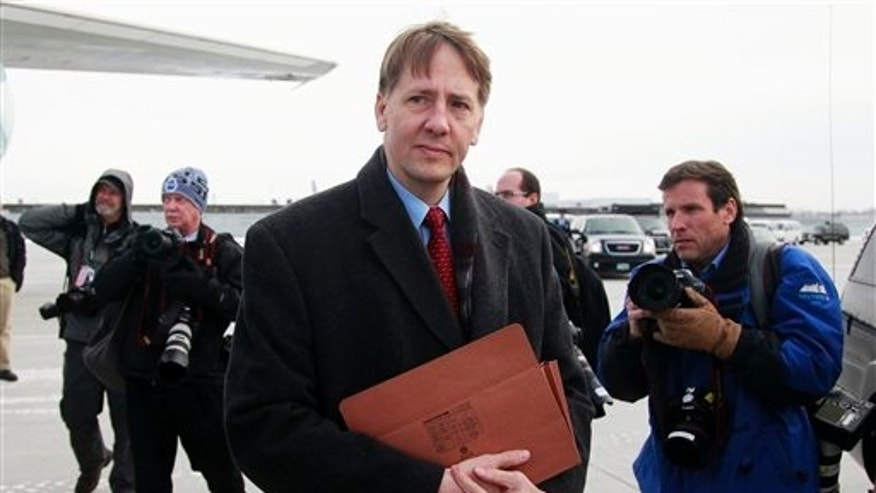 Jan. 4: former Ohio Attorney General Richard Cordray is photographed by the media in Cleveland.
