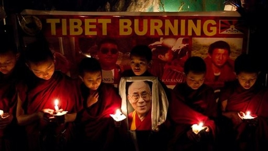 Jan. 24: Tibetan novice monks from Kirti monastery participate in a candlelight vigil to protest against violence by Chinese police against demonstrators in Tibet, at Dharmsala, India.