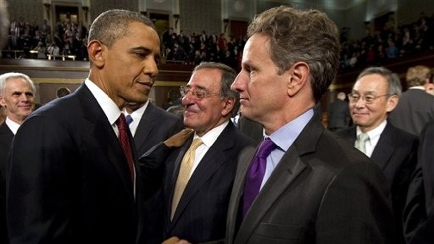 Jan. 24, 2012: President Obama greets Treasury Secretary Timothy Geithner following his State of the Union address in front of a joint session of Congress.