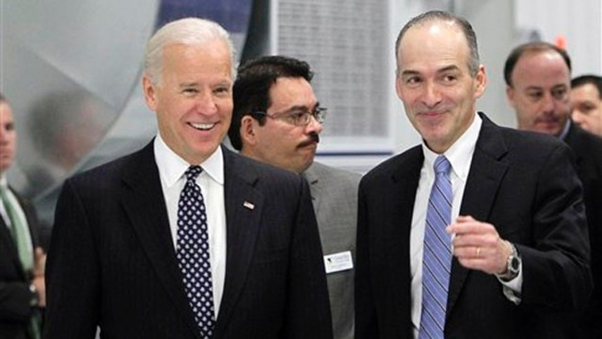 Jan. 26, 2012: Vice President Biden walks with Dr. Joseph Morone, president and CEO of Albany International Corp., in Rochester, N.H.