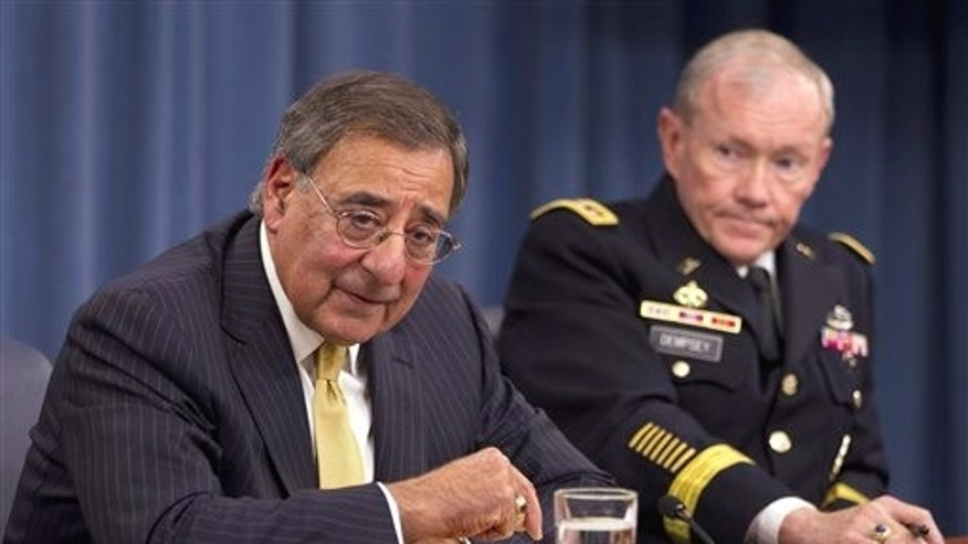 FILE - In this Nov. 10, 2011, file photo Defense Secretary Leon Panetta and Joint Chiefs Chairman Gen. Martin Dempsey take part in a news conference at the Pentagon in Washington.