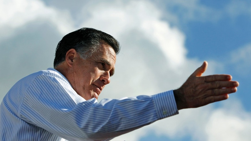 Republican presidential candidate, former Massachusetts Gov. Mitt Romne campaigns at Paramount Printing in Jacksonville, Fla., Thursday, Jan. 26, 2012. (AP Photo/Charles Dharapak)