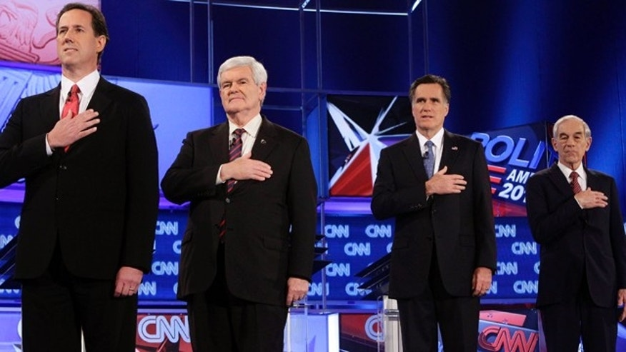 Jan. 26, 2012: From left, Rick Santorum, Newt Gingrich, Mitt Romney and Ron Paul stand for the national anthem before a Republican presidential debate in Florida.