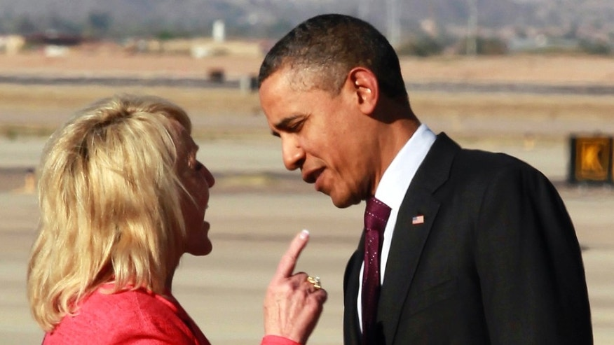 Arizona Gov. Jan Brewer points at President Barack Obama after he arrived at Phoenix-Mesa Gateway Airport. (AP Photo/Haraz N. Ghanbari)