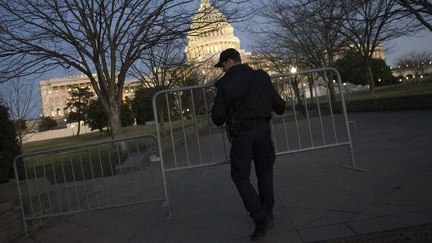 Jan. 24, 2012: Capitol Police officers secure the sidewalks around the U.S. Capitol before the State of the Union address on Capitol Hill.