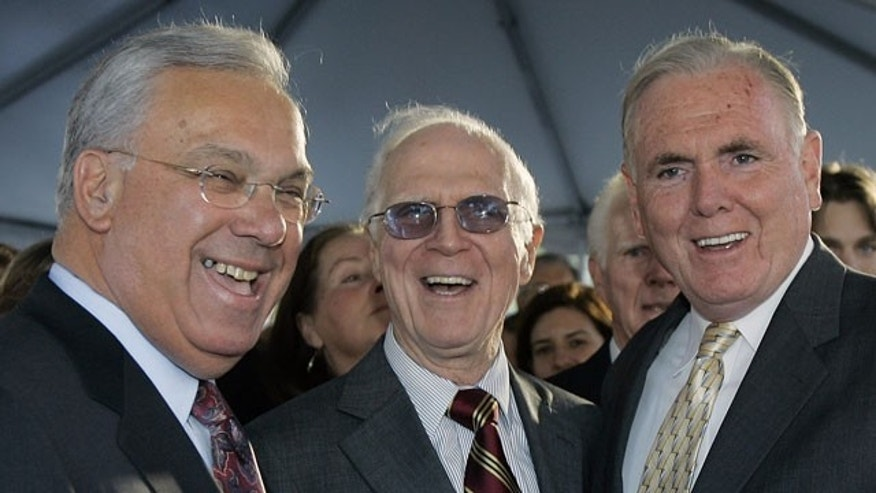 In this, Wednesday, Nov. 1, 2006. file photo, former Boston Mayor Kevin White, center, laughs with current Mayor Thomas Menino, left, and former Mayor Raymond Flynn prior to the unveiling of a bronze statue bearing White's likeness outside Faneuil Hall near Quincy Market in Boston.