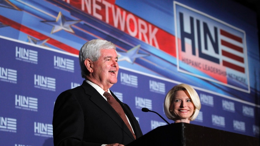 Republican presidential candidate, former House Speaker Newt Gingrich, accompanied by his wife Callista, speaks during Hispanic Leadership Network conference at the Doral Golf Resort and Spa, Friday, Jan. 27, 2012, in Miami, Fla. (AP Photo/Matt Rourke)