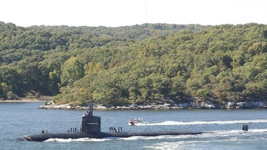 Oct. 8, 2010: The submarine USS Providence transits the Thames River as it departs Naval Submarine Base New London in Groton, Conn., in this file photo.