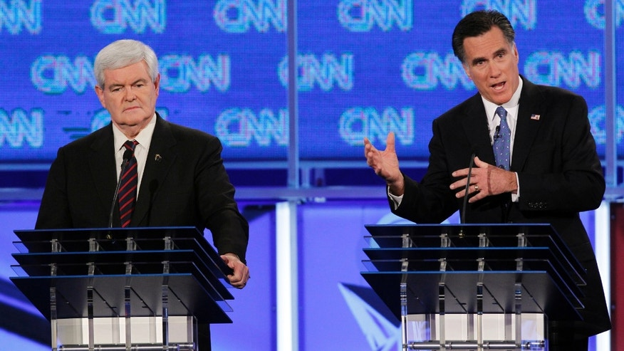 Republican presidential candidates former House Speaker Newt Gingrich and former Massachusetts Gov. Mitt Romney participate in the Republican presidential candidates debate at the University of North Florida in Jacksonville, Fla., Thursday, Jan. 26, 2012. (AP Photo/Matt Rourke)