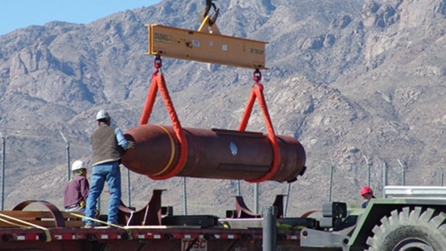 In this 2007 file photo the Massive Ordnance Penetrator conventional bomb is off-loaded at White Sands Missile Range, N.M.