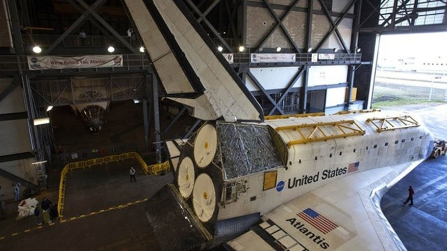 Jan. 20, 2012: The space shuttle Atlantis is moved into the huge Vertical Assembly Building for work in its decommissioning at the Kennedy Space Center in Cape Canaveral, Fla.