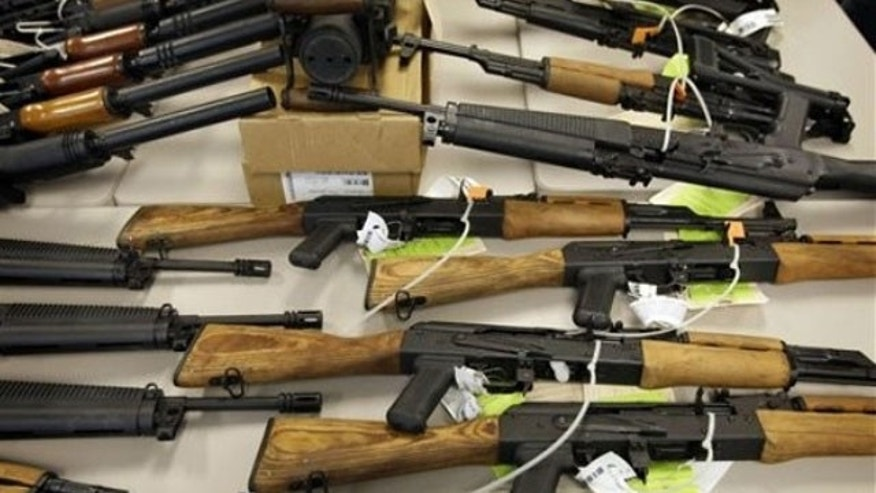 Jan. 25, 2011: A cache of seized weapons used in the ATF gun-running operation 'Fast and Furious' is displayed at a news conference in Phoenix.