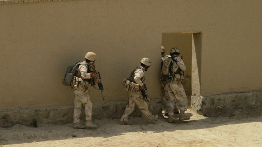 FILE: Afghan Security Forces move from one area to the next during a training exercise.