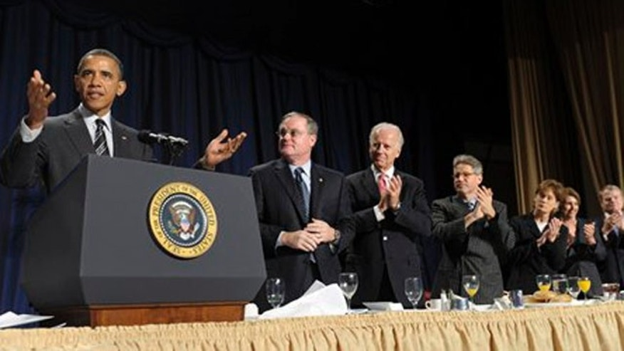 Feb. 2, 2012: President Barack Obama gestures while speaking at the National Prayer Breakfast in Washington.