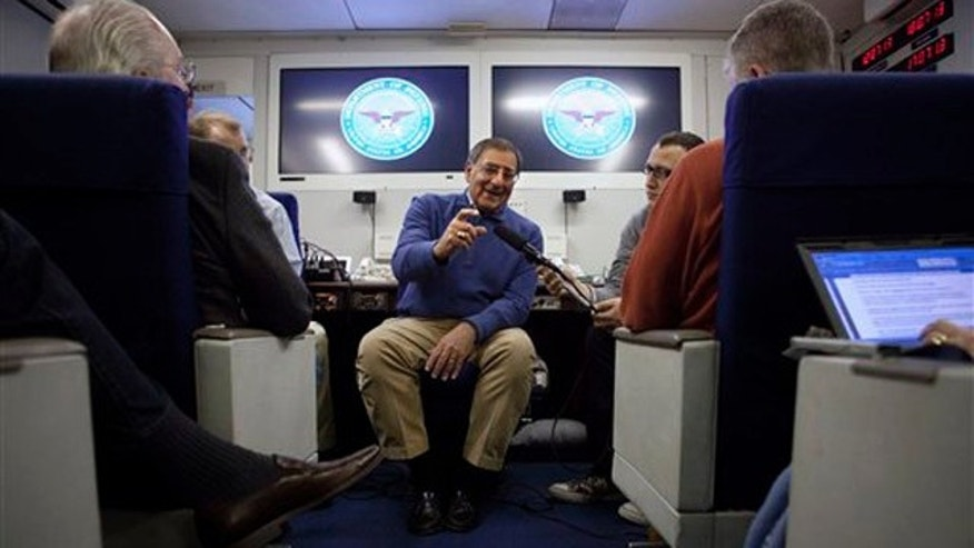 Feb. 1, 2012: Defense Secretary Leon Panetta briefs the media on board a plane en route to a NATO conference in Brussels, Belgium.