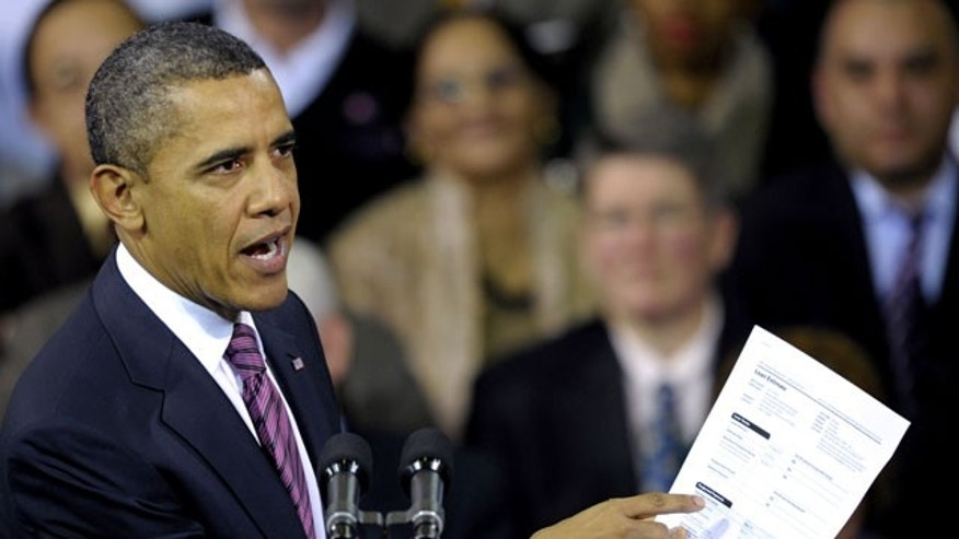 Feb. 1, 2012: President Barack Obama holds up a proposed mortgage application form as he speaks at the James Lee Community Center in Falls Church, Va.