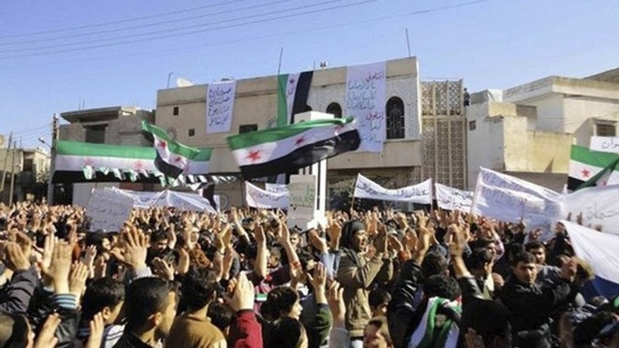 Feb. 3, 2012: Demonstrators protest against Syria's President Bashar al-Assad after Friday prayers in Talbiseh near Homs.