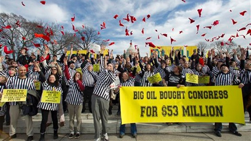 Jan. 24, 2012: Protesters against the Keystone XL pipeline dressed as referees throw red penalty flags during a rally on Capitol Hill.