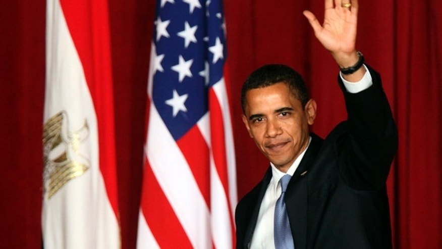 June 4, 2009: U.S. President Obama waves to the audience as he leaves the Grand Hall of Cairo University after delivering a speech in Cairo.