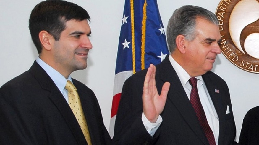 In this Jan. 23, 2009, file photo, Sam Lahood stands by as his father, Ray LaHood, is sworn in as transportation secretary.