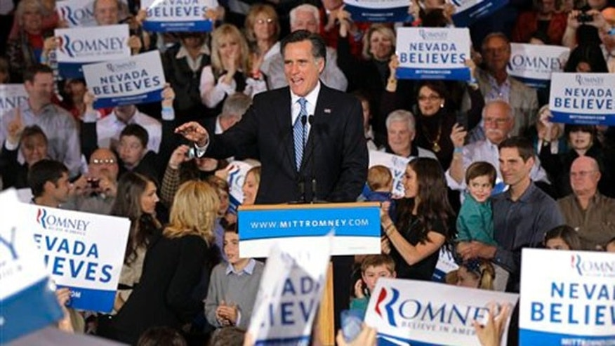 Republican presidential candidate former Massachusetts Gov. Mitt Romney greets supporters at his Nevada caucus night victory celebration in Las Vegas, Saturday, Feb. 4, 2012. (AP Photo/Julie Jacobson)