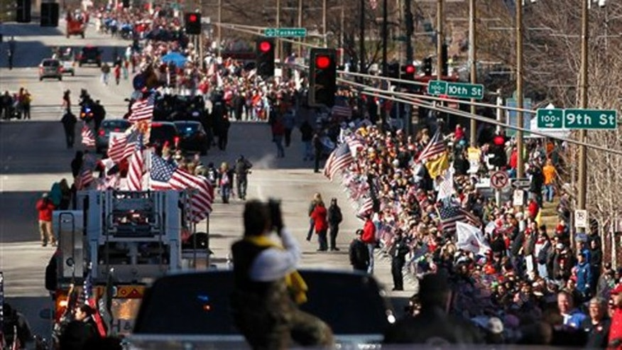 Jan. 28, 2012: Thousands line a downtown street to watch a parade to honor Iraq War veterans in St. Louis.
