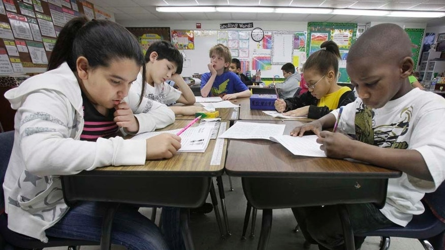 In this photo made Tuesday, Feb. 15, 2011, third grade students do school work during class at Hanby Elementary School in Mesquite, Texas. Mesquite ISD, like many districts in Texas, has seen a demographic shift in the racial make up students over the past 10 years. Hispanics account for two-thirds of Texas' growth over the past decade and now make up 38 percent of the state's total population, according to new local U.S. Census figures released Thursday, Feb. 17, 2011. (AP Photo/LM Otero) (AP Photo/LM Otero)