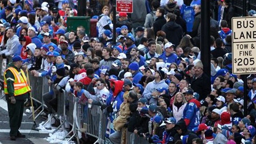 Feb. 7, 2012: Fans line the streets in lower Manhattan waiting for the start of the New York Giants Superbowl parade in New York.