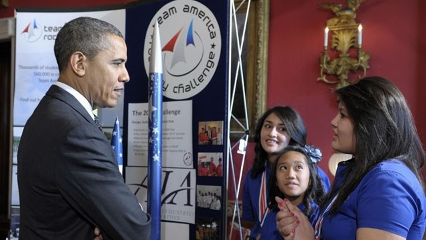 Feb. 7, 2012: President Barack Obama talks with, from left, Janet Nieto, Gwynelle Condino, and Ana Nieto, all from Presidio, Texas, in the State Dining Room of the White House in Washington during the White House Science Fair.