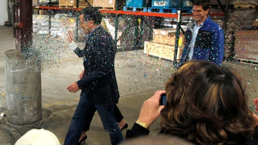 Feb. 1, 2012: Republican presidential candidate Mitt Romney is 'glitter bombed' as he walks to the stage in Eagan, Minn. A more recent attack ended in the alleged attacker's arrest.