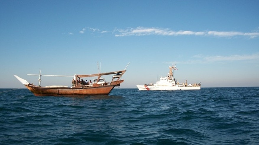 "January 2010: U.S. Coast Guard Cutter Monomoy conducting an ""interaction patrol,"" pictured with a fishing dhow in the Persian Gulf."