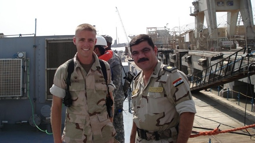 "Lt. Joseph ""Grant"" Thomas, Jr., with the executive officer of an Iraqi navy ship; taken October 2009 in Umm Qasr, Iraq."