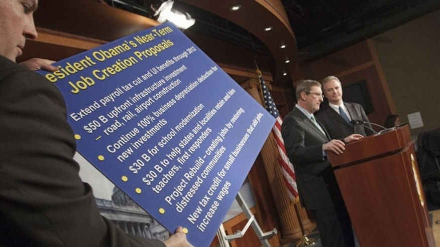 Feb. 13, 2012: Senate Budget Committee Chairman Sen. Kent Conrad, D-N.D., center, and Rep. Chris Van Hollen, D-Md., the ranking Democrat on House Budget Committee, gestures during a news conference on Capitol Hill in Washington.