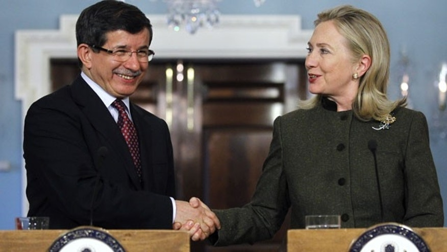 Feb. 13, 2012 Secretary of State Hillary Rodham Clinton and Turkish Foreign Minister Ahmet Davutoglu shake hands during a joint news conference at the Department of State in Washington.