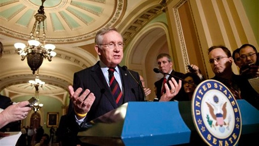 Feb. 14, 2012: Senate Majority Leader Harry Reid talks to reporters about the payroll tax cut on Capitol Hill.