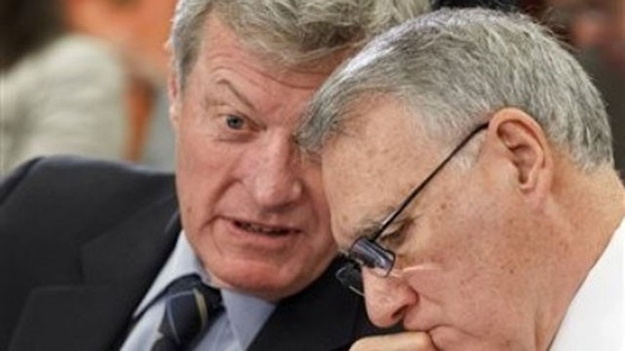 Feb. 1, 2012: Senate Finance Committee Chairman Sen. Max Baucus, D-Mont., left, and Senate Minority Whip Jon Kyl of Ariz. , confer during a meeting of the Payroll Tax conferees, on Capitol Hill in Washington.