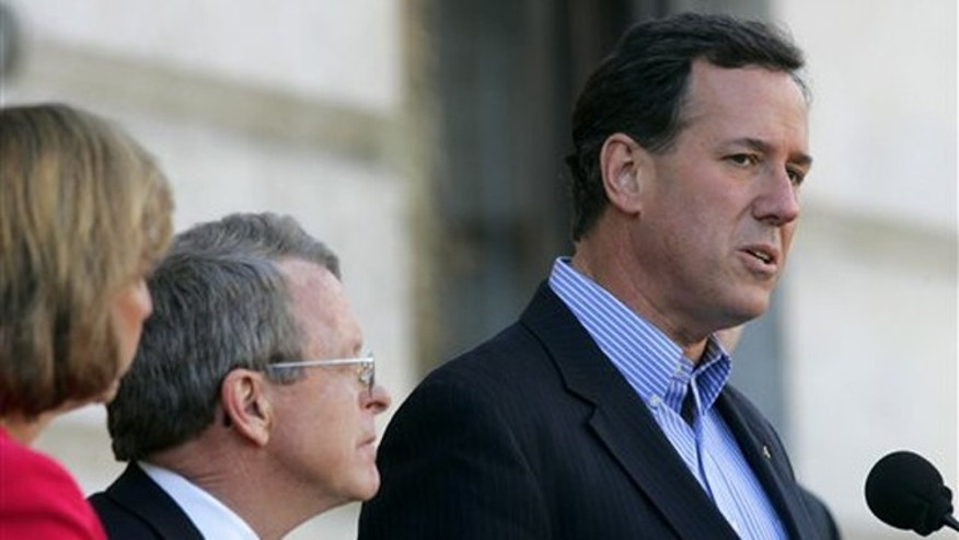 Feb. 17, 2012: Rick Santorum, right, accompanied by Ohio Attorney General Mike DeWine and DeWine's wife Fran, speaks outside of the Ohio Statehouse in Columbus, Ohio.
