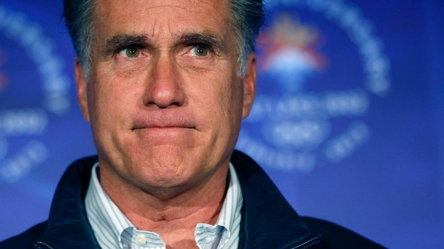 Republican presidential candidate, former Massachusetts Gov. Mitt Romney, pauses while speaking to a group of former Salt Lake City Olympics committee members, marking the tenth anniversary of the games, in Salt Lake City, Utah, Saturday, Feb. 18, 2012. (AP Photo/Gerald Herbert)