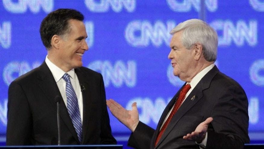 January 19, 2012: Republican presidential candidates, former Massachusetts Gov. Mitt Romney and former House Speaker Newt Gingrich talk during a commercial break at the Republican presidential candidate debate at the North Charleston Coliseum in Charleston, S.C.