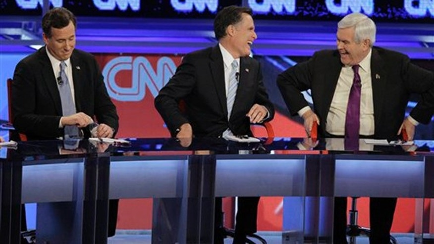 Feb. 22, 2012: Rick Santorum, left, Mitt Romney, center, and Newt Gingrich participate in a debate in Mesa, Ariz. Ron Paul, not shown, also participated.