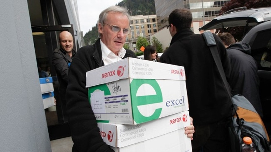 June 10: A reporter carries boxes containing thousands of pages of Sarah Palin's emails from her time as Alaska's governor in Juneau, Alaska.