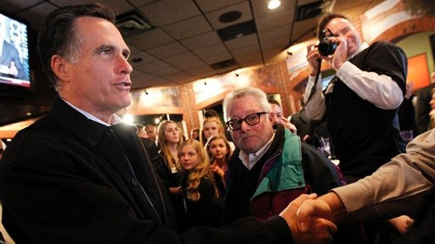 Feb. 24, 2012: Mitt Romney greets patrons at The Mitt Restaurant during a campaign stop in Mount Clemens.