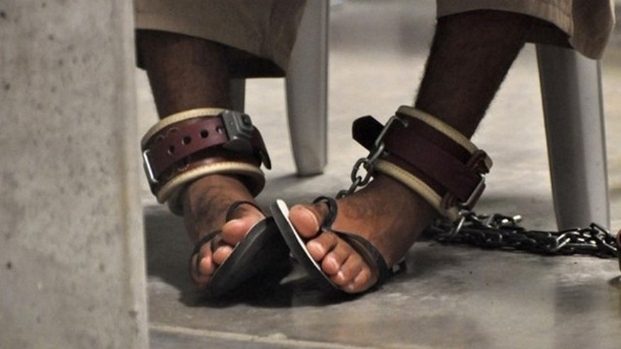 "In this April 27, 2010, file photo, reviewed by a U.S. Department of Defense official, a Guantanamo detainee's feet are shackled to the floor as he attends a ""Life Skills"" class inside Camp 6, the high-security detention facility at Guantanamo Bay U.S. Naval Base."