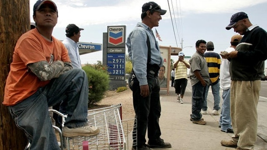 Day laborers wait for work near a Home Depot store in Phoenix.