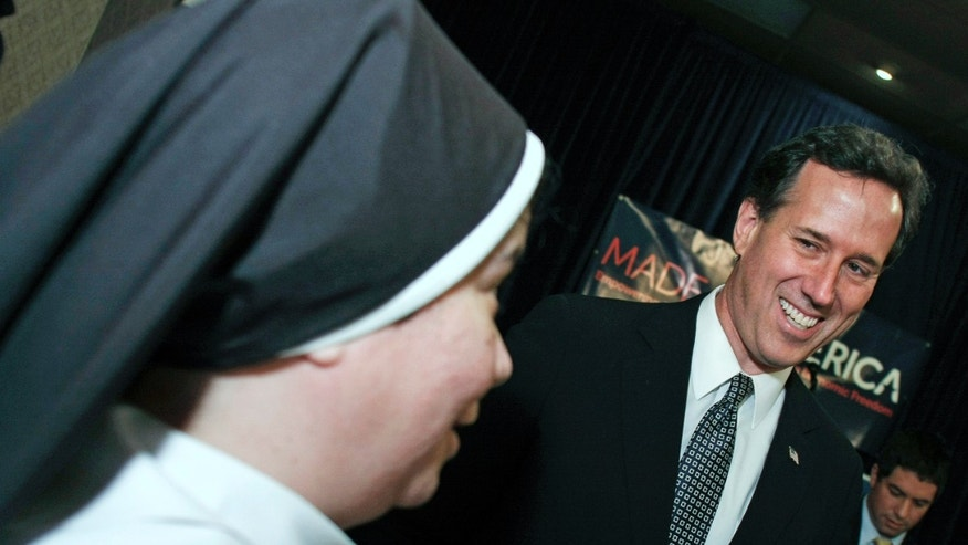 LINCOLN PARK, MI, - FEBRUARY 24:  Republican Presidential Candidate and former U.S. Sen. Rick Santorum (R-PA) (R) greets a catholic nun. (Photo by Bill Pugliano/Getty Images)
