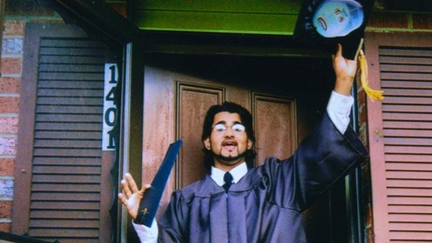 FILE 1999: Majid Khan gestures during his high school senior year in Baltimore, MD.