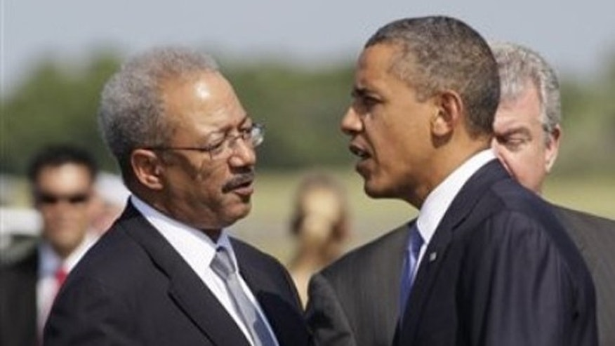 FILE: Rep. Chaka Fattah, D-Pa. talks with President Barack Obama as he steps off of Air Force One.